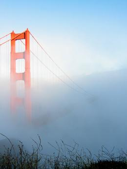 The Golden Gate Bridge rising out of the fog, as seen from the Marin Headlands, Doug VK - March 2011