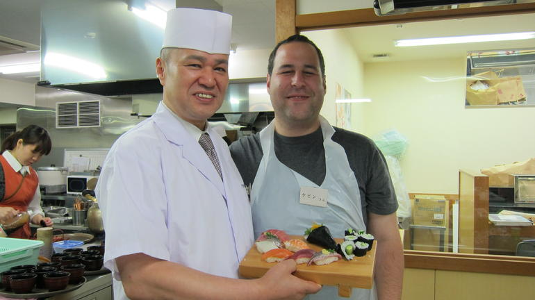 My husband with the sushi he made and the chef/teacher - Tokyo