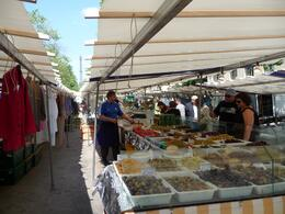 You can see the Eiffel tower in between the market stalls. The variety of olives was great!, Chou Fleur - October 2010
