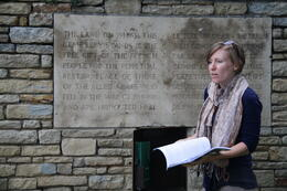 Our guide Julie explains the movement of battle lines with the aid of a map at the cemetry. , Bryan S - July 2014