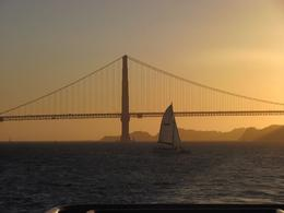 Photo of San Francisco Jail and Sail: Alcatraz Tour and Sunset Bay Cruise Golden Gate Bridge at sunset.