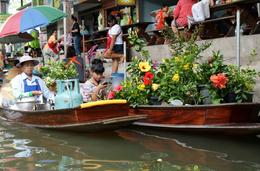 Photo of Bangkok Floating Markets and Bridge on River Kwai Tour from Bangkok Loving the girl on her mobile phone.