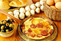 Greek cuisine: Greek omelette with smoked sausage, bacon and potatoes - May 2011