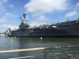This is a view of the Intrepid as you approach it on the tour. The big white hangar on the stern is where the Space Shuttle Enterprise is located. All included with the price of the ticket. , Joe S - September 2015