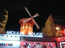 To enter Moulin Rouge you have to be in a que and while waiting in our que, I took the opportunity of running across the road and taking a few pictures. I wish they allowed us to take pictures inside ... , Zahid N - October 2009