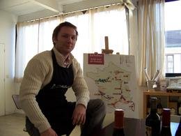 Our host and his map of French wine making regions in his loft., Matthew R - December 2007