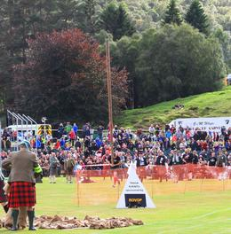 Photo of Edinburgh Scottish Highland Games Day Trip from Edinburgh Highland Games Log Lifting Competition, Braemar, Scotland, 2013