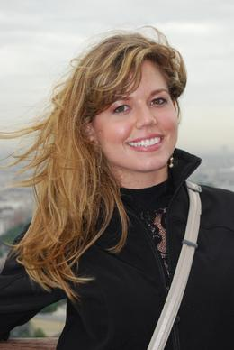 Jessica on the Eiffel Tower with a background of Paris. - June 2008