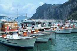 Photo of Rome Capri Day Trip from Rome boats waiting to take you to the grotto