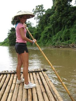 Nicole tries steering the bamboo raft., Carolyn G - August 2008
