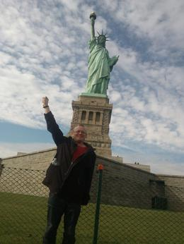 This is a photo of myself by the statue of liberty enjoying myself ! , Jamie E - November 2013