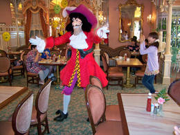 Photo of Orlando Disney Character Breakfast at Chef Mickey's Disney Contemporary Resort Captain Hook dances at Breakfast in the Park with Minnie & Friends