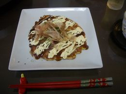 The finished Okonomiyaki dressed with sweet soya sauce, mayonaise and bonito flakes , Ben - November 2015