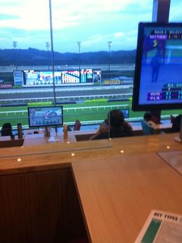 Photo of Singapore Singapore Turf Club: Horse Racing with VIP Lounge Access Computer screen on every table