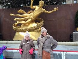Photo of New York City Viator VIP: Rockefeller Center Ice Skating Experience and Top of the Rock Observation Deck Happy girls on the Rink