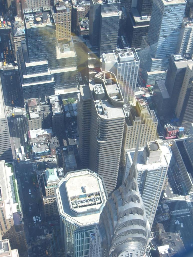 Hovering over the tip of the Chrysler Building - New York City