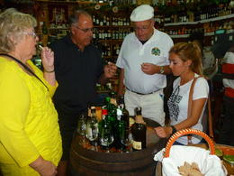 Virginia took us wine tasting in a couple of different places. This picture captured our group in a family owned deli, the owner brought out delicious aged cheeses and meats for us to experience ... , Cynthia P - October 2013