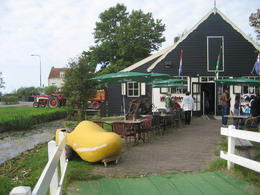 Photo of Amsterdam Amsterdam Super Saver: Zaanse Schans Windmills, Delft and The Hague Day Trip How to make a clog