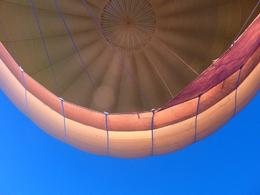 Our balloon lit up against the morning sky. - December 2009