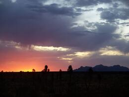 Sunset, with clouds blowing in over Ayers Rock. - June 2008