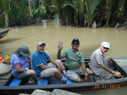 Photo of Ho Chi Minh City Mekong Delta Discovery Small Group Adventure Tour from Ho Chi Minh City On a small boat while negotiating a water channel towards Mekong river.