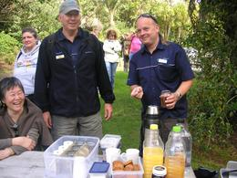 Photo of Auckland Waitakere Ranges Wilderness Experience Eco-Tour from Auckland Tour guides with drinks