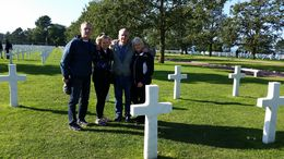Ann-Sophia took us to the American Cemetery at the end of our day when they were lowering the American Flag and playing Taps. A very special time for us. Photo of Jim Houghton and Connie Nelson, ... , Judy H - October 2015