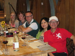 My husband and tour group enjoying wine and lunch at a vineyard in Montalcino , Lee - April 2015