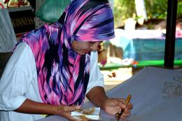 One of the workers who paint by hand the patterns on the clothing , Peter T - May 2011