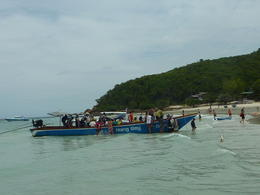 our speedboat halted much farther away from beach than these long boats. , Bhanu - August 2012