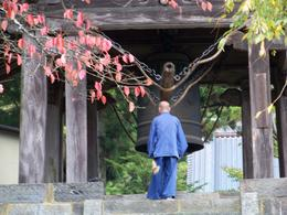 Photo of Tokyo Nikko National Park Day Trip from Tokyo Monk ringing temple bell at noon