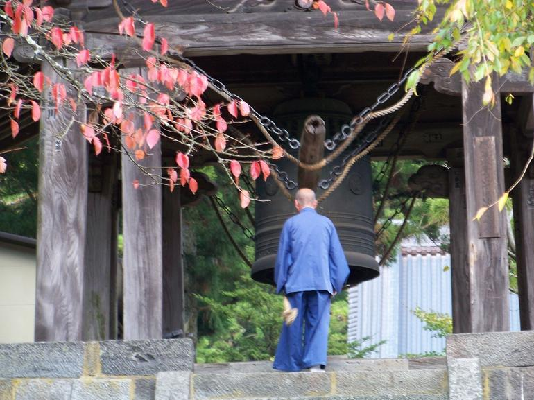 Monk ringing temple bell at noon - Tokyo