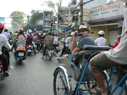 My husband on a cyclo amidst the masses of scooters. , Leanne B - April 2011