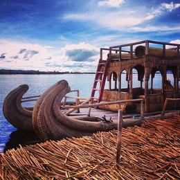 A boat made by the people of the floating Uros Islands , Kaitlyn B - January 2014