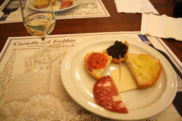 A tasty white wine, served with olive tapenade, bruschetta, pecorino cheese and salami - wonderful! , Michelle N - February 2011
