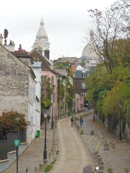 Photo of Paris Montmartre Impressionist Art Walking Tour Including Skip-the-Line Musee d'Orsay Ticket A narrow street of Montmartre