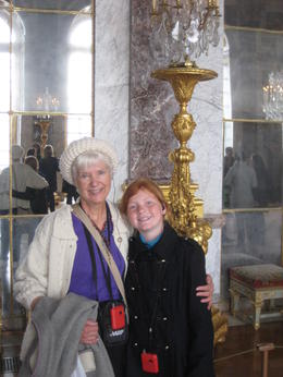 Susan and her grandaughter in the Hall of Mirrors, Versailles, taken by he genial guide. - April 2013