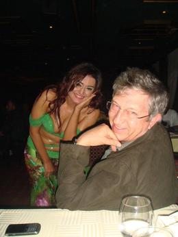 My husband enjoying the belly dancer. , Andre E - October 2011