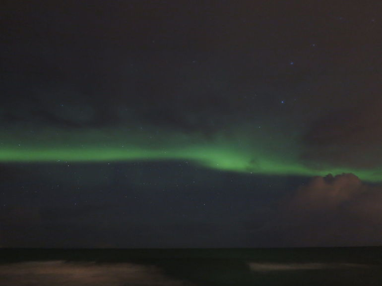 Only slightly visible and not legal northern light but amazing through the camera.