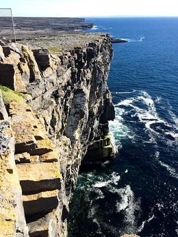 Dún Aonghasa Yikes! Like the Cliffs of Moher without the railings!! Just think of the history.. if these stones could talk! Beautiful! Scary! You'd never see this in the States... lawsuits up ... , ann r - November 2015
