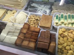 So many sizes and shapes of tofu in the market we visited , Anna M - January 2016