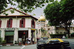 Singapore's Arab Street heritage area. The oldest mosque in the city in the background. Original old shop houses in foreground. - October 2012