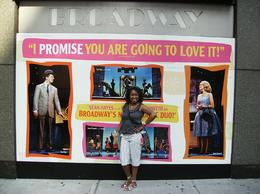 "In this picture, I'm in Times Square trying to blend in with the advertisment for a Broadway show. Notice that the caption behind me reads; ""I PROMISE THAT YOU ARE GOING TO LOVE IT"". My ... , CAMILLIA A - August 2010"