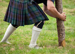 Photo of Edinburgh Scottish Highland Games Day Trip from Edinburgh Competitor about to lift a caber