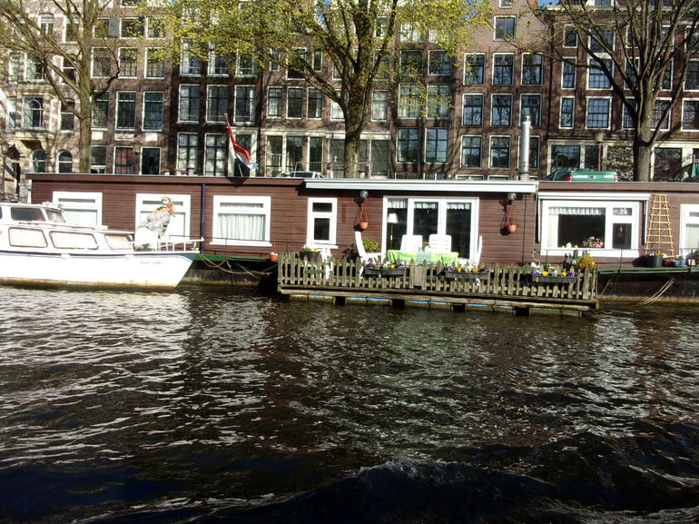 A couple of the 2500 permanent houseboats along the canals of Amsterdam, that are now quite pricey.
