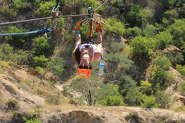 adding to the excitement--zip lining backwards!, Casey - October 2013