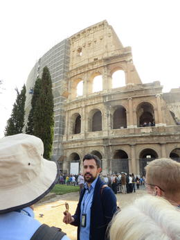 Maurizio telling us about the original extent of the Colosseum , Shalley L - April 2014