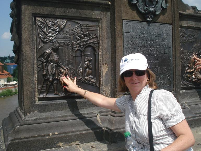 Making a wish on the Charles Bridge, Prague - Vienna