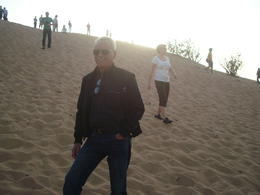 Photo with the Sun setting behind the dunes in the desert. , Petronio B - January 2012