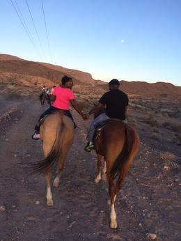 Photo of Las Vegas Wild West Sunset Horseback Ride with Dinner Riding into the sunset